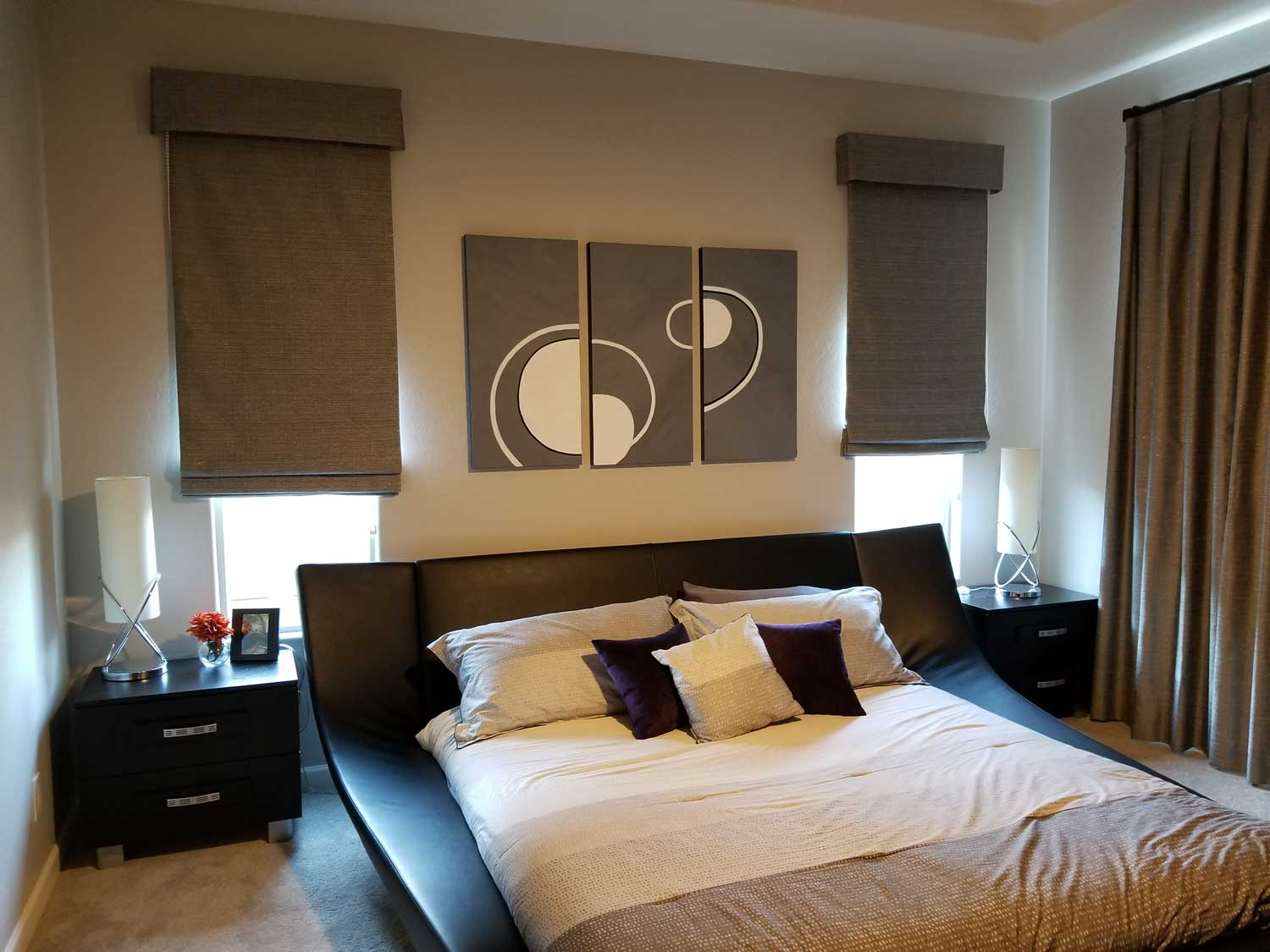 Flat Roman Shades with Valance in a furnished bedroom