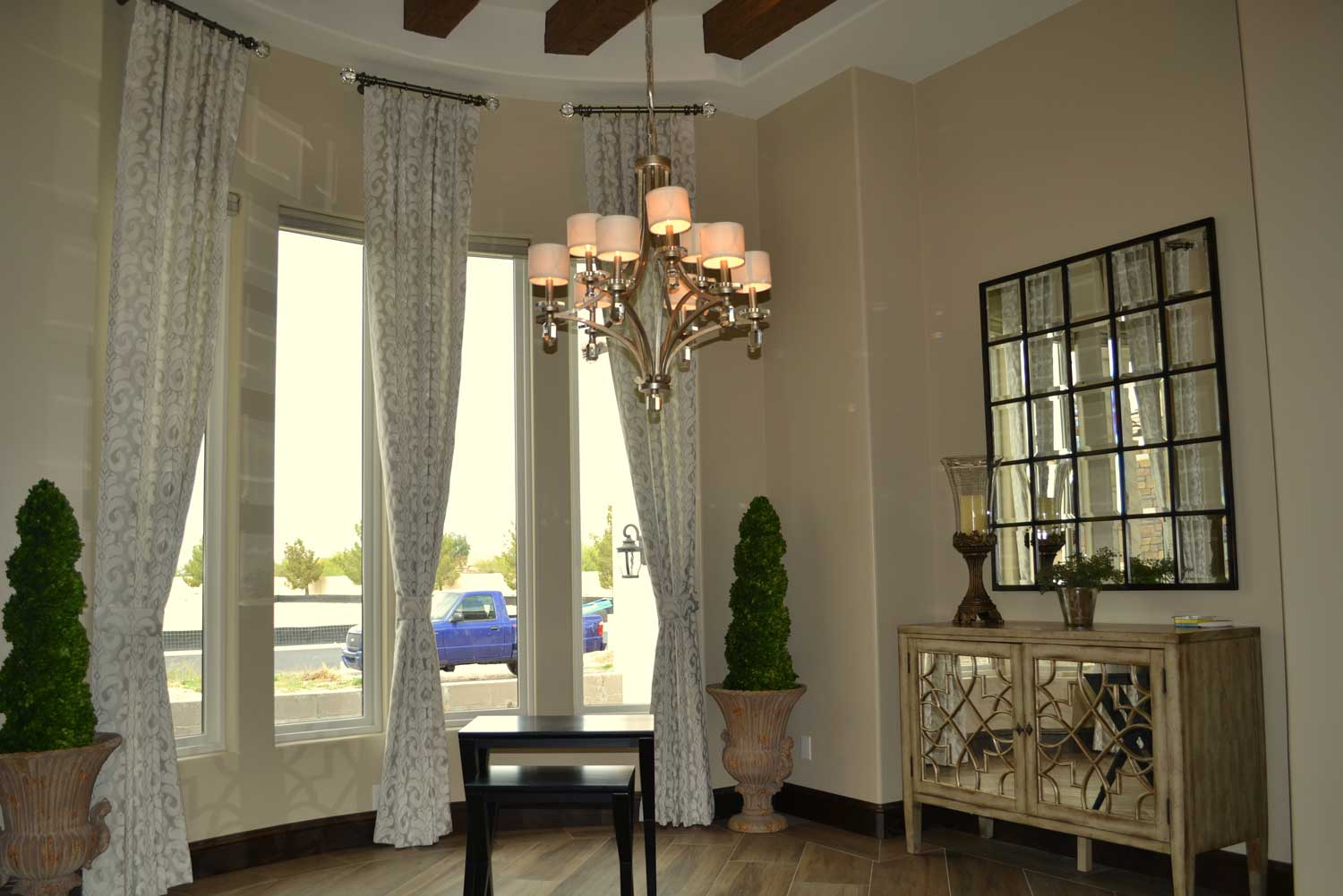 well-furnished living space with large windows