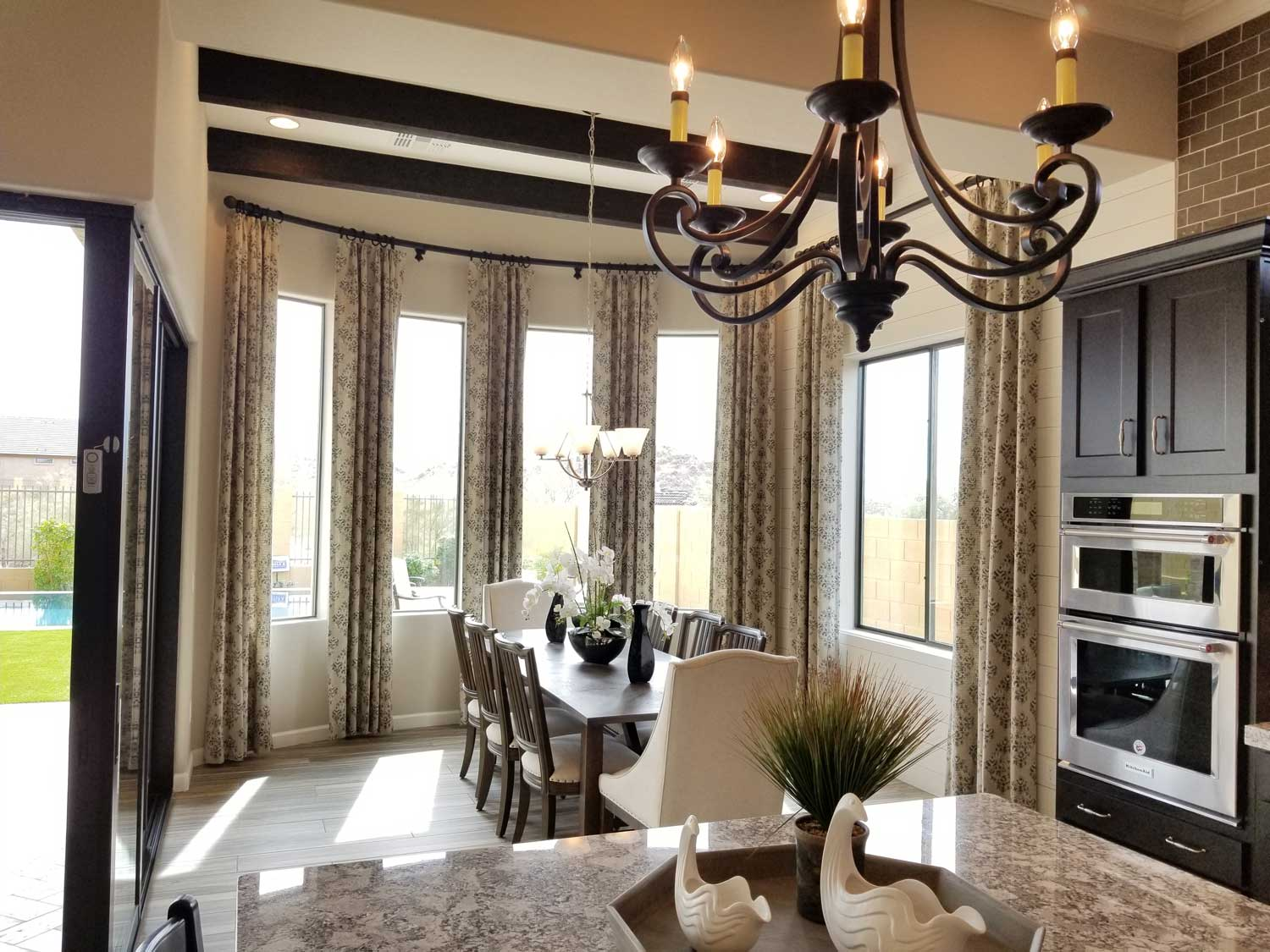 curved windows around a dining space