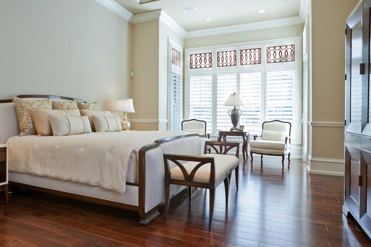bedroom with cot, chairs and window with shutters
